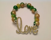 Rhinestone 'Love' Bracelet With Iridescent Yellow and Green Beads. Fits Most Wrists.