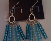 A tear drop chandler accented with blue shades of seed beads.