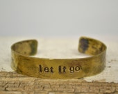 let it go handstamped on brass cuff/bracelet