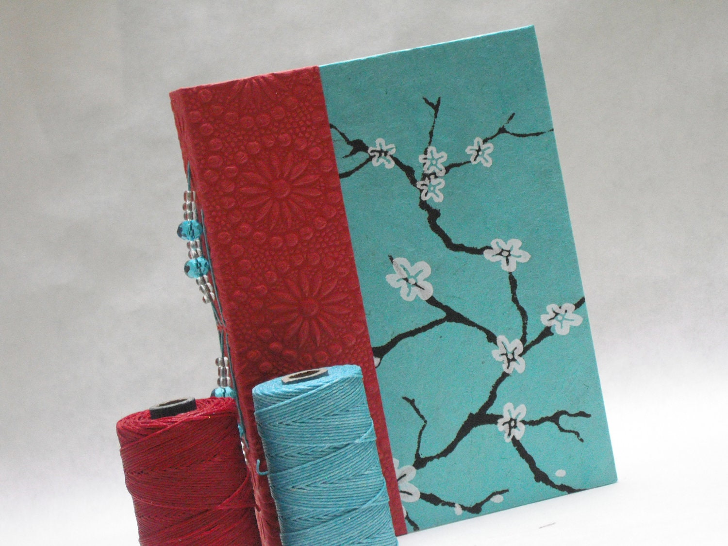 Aqua and red handmade hardcover journal with beaded spine
