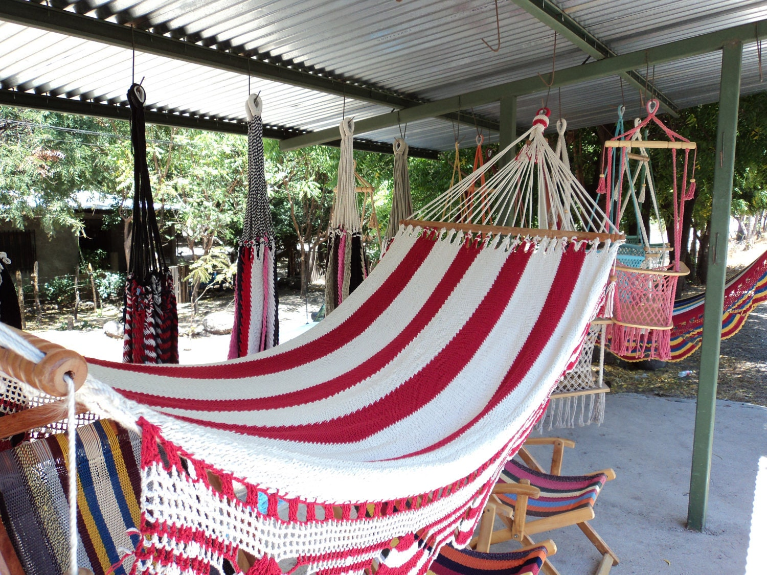 Red And Blue Hammock With Wood
