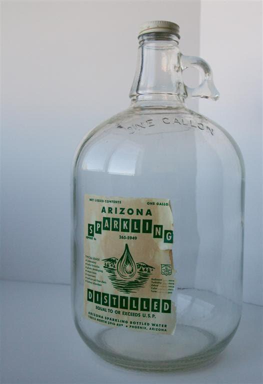distilled water in glass jug