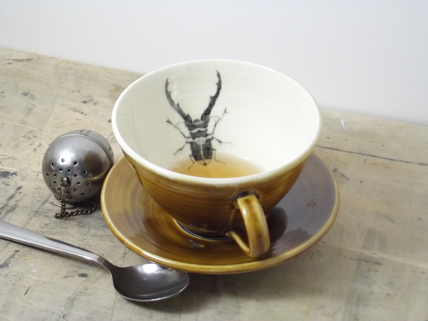 Porcelain Dark Amber Stag Beetle Tea Cup and Saucer - FaithAdamsCeramics