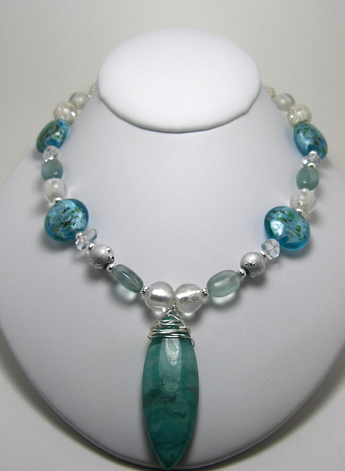 Crystal Blue Persuasion necklace with blue jasper drop, glass and foil beads, fluorite, and silverplated beads