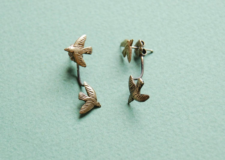 Floating golden bird stud earrings