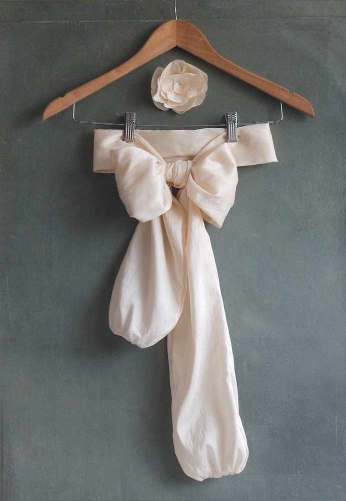 Cream taffeta bow belt and magnolia flower brooch