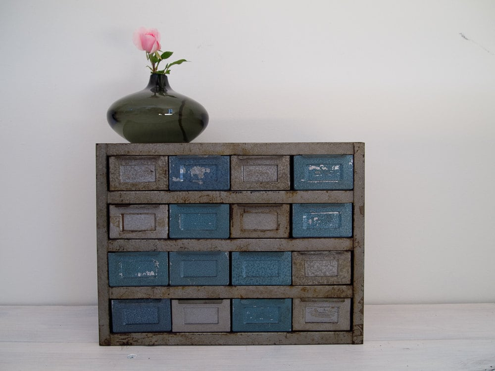 vintage industrial metallic blue and silver metal storage cabinet