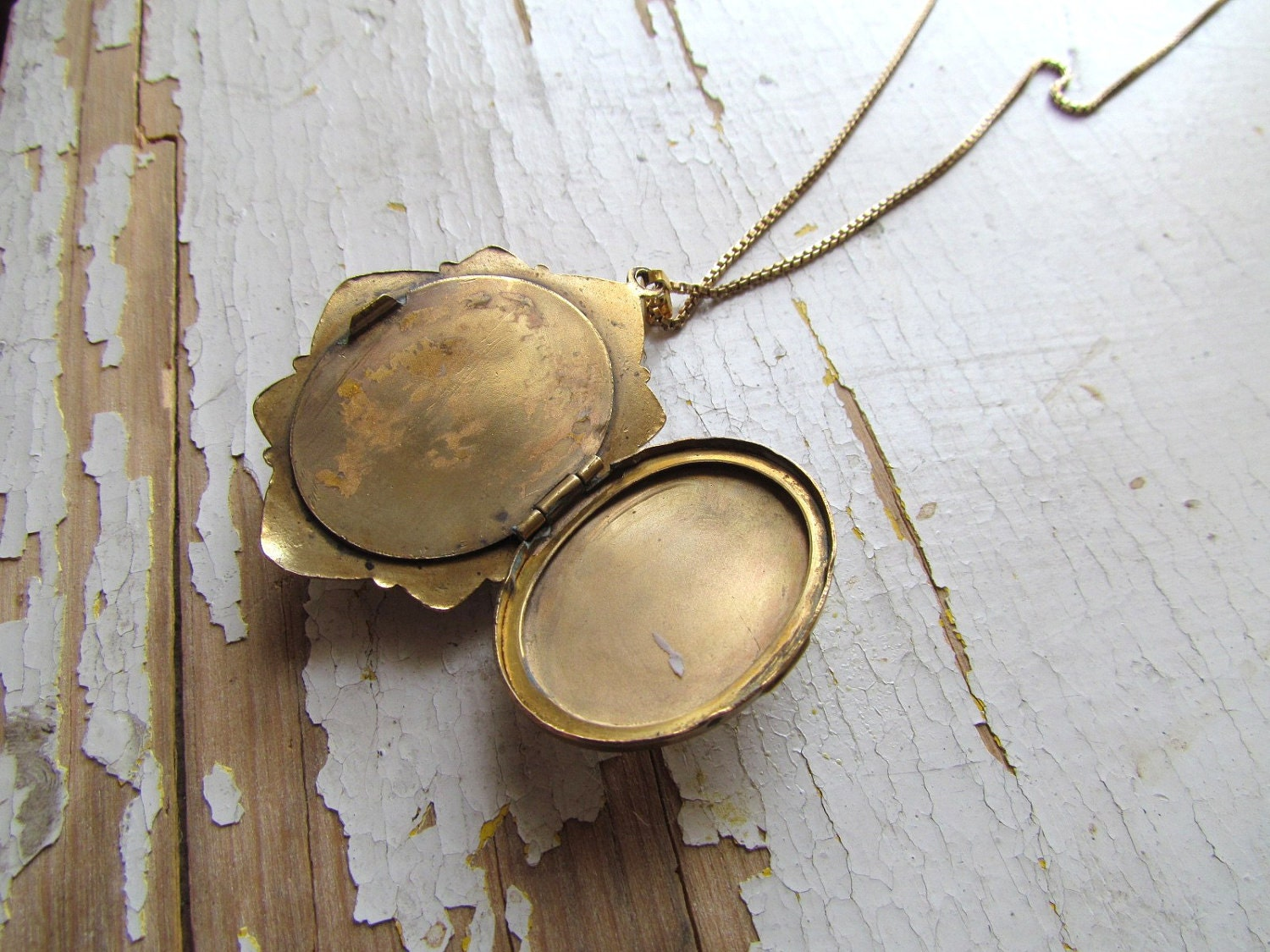 it is set on a 10k gold filled locket with an eight point star shape design