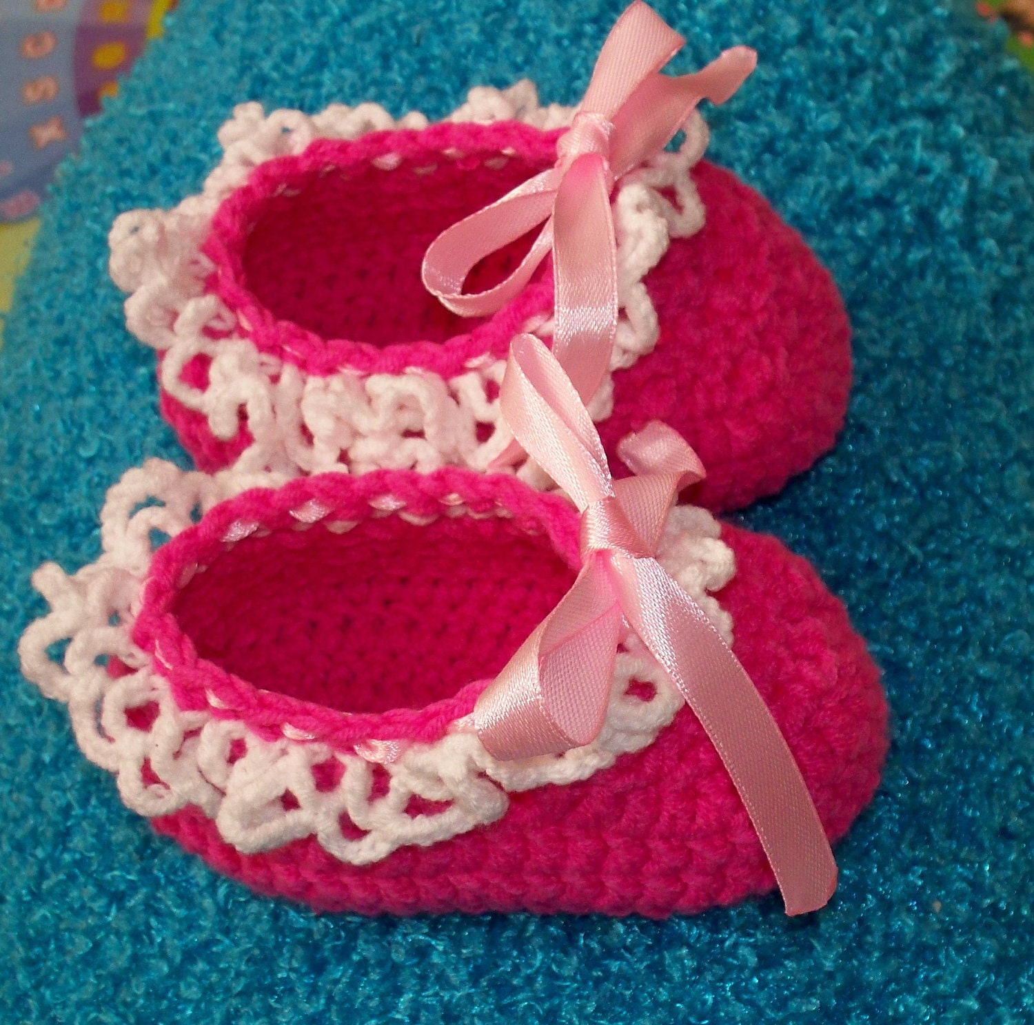 Baby booties with a cobweb of lace