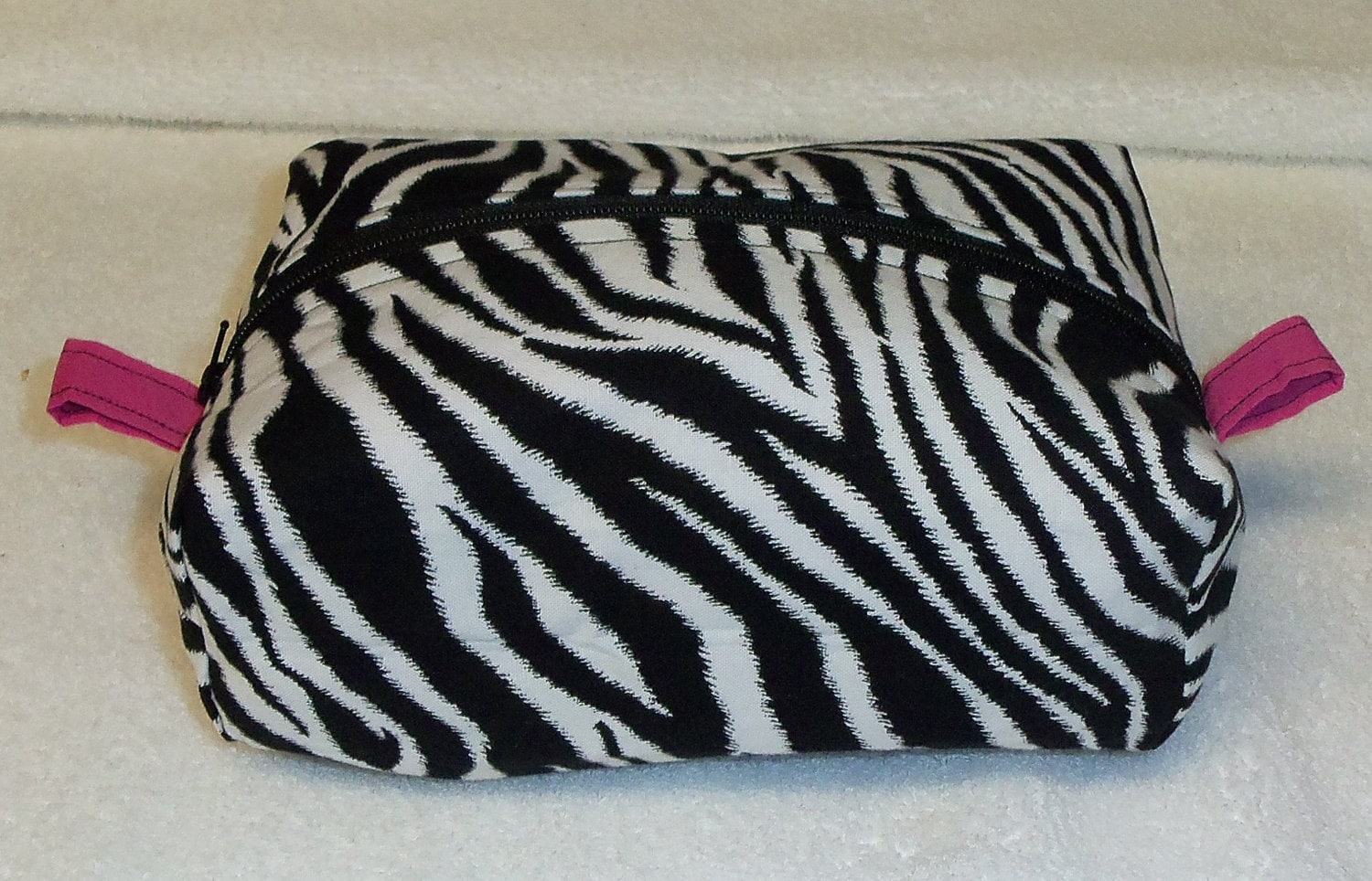 Makeup Bag with top Zipper. Lined with coordinating material and all Hand Crafted.  Zebra Print and Pink