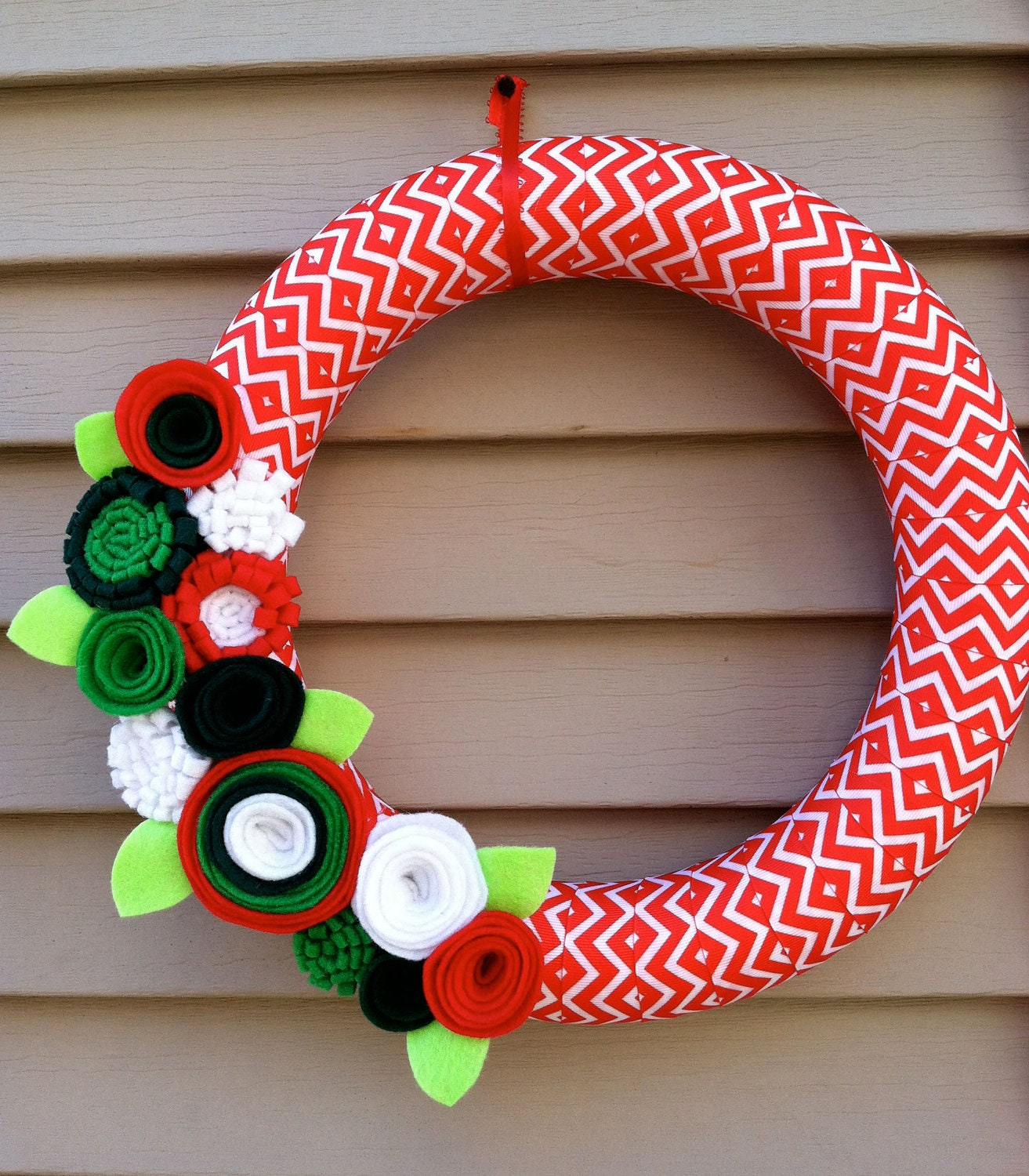 Christmas Wreath wrapped in Chevron Christmas Ribbon decorated with felt flowers. Great for the Holidays. Holiday Wreath. Christmas Wreath