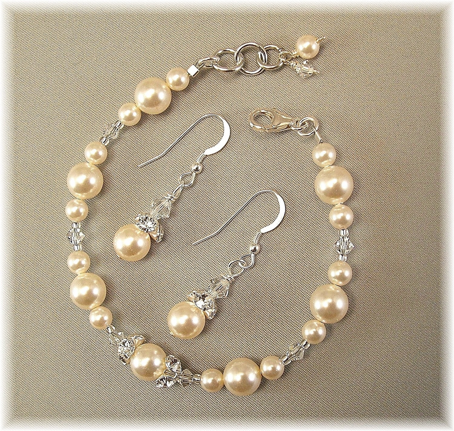 Ivory Pearl and Crystal Bracelet and Earring Sets by Handwired from etsy.com