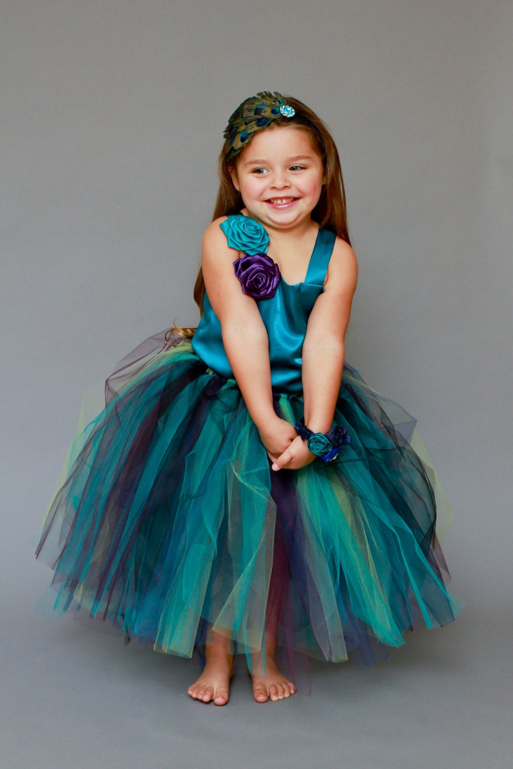 The Haven..Pretty in Peacock 2 Piece Satin Top with Satin Rolled Flowers and Floor length Peacock Tutu Skirt.. Free gift with purchase...