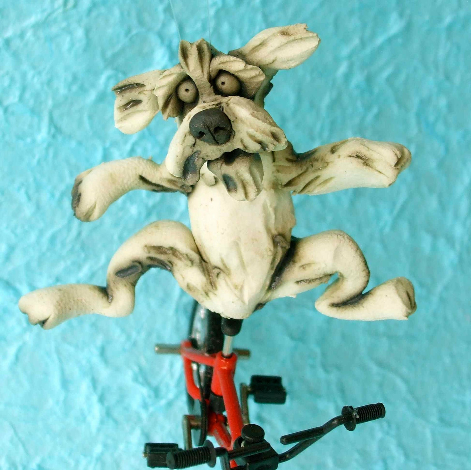 Dog Riding a Bicycle Sculpture