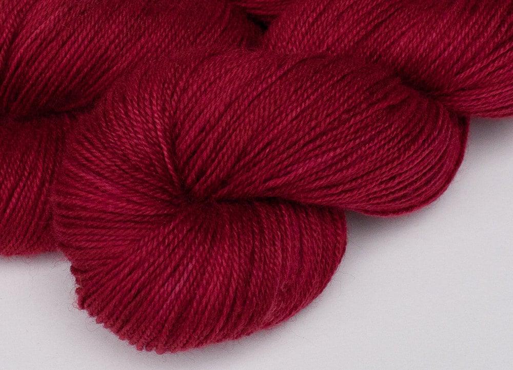 Red handpainted fingering yarn: GARNET on Blue-Faced Leicester/nylon sock, 4 oz