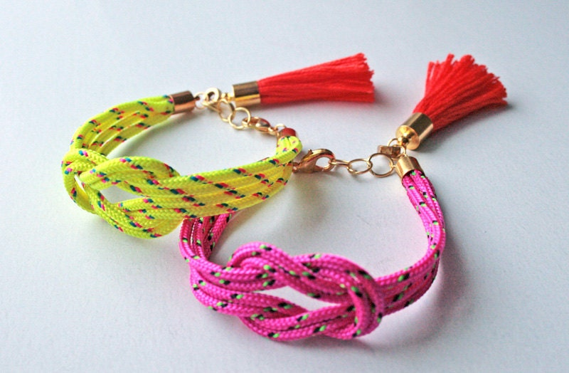 Neon pink knot rope bracelet with tassel charm