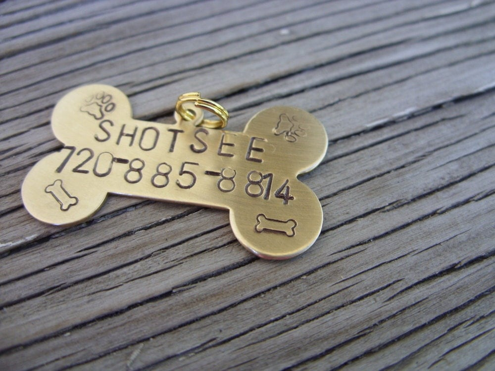 Hand stamped brass dog tag bone  with name and phone number 19x32mm - beadsoul