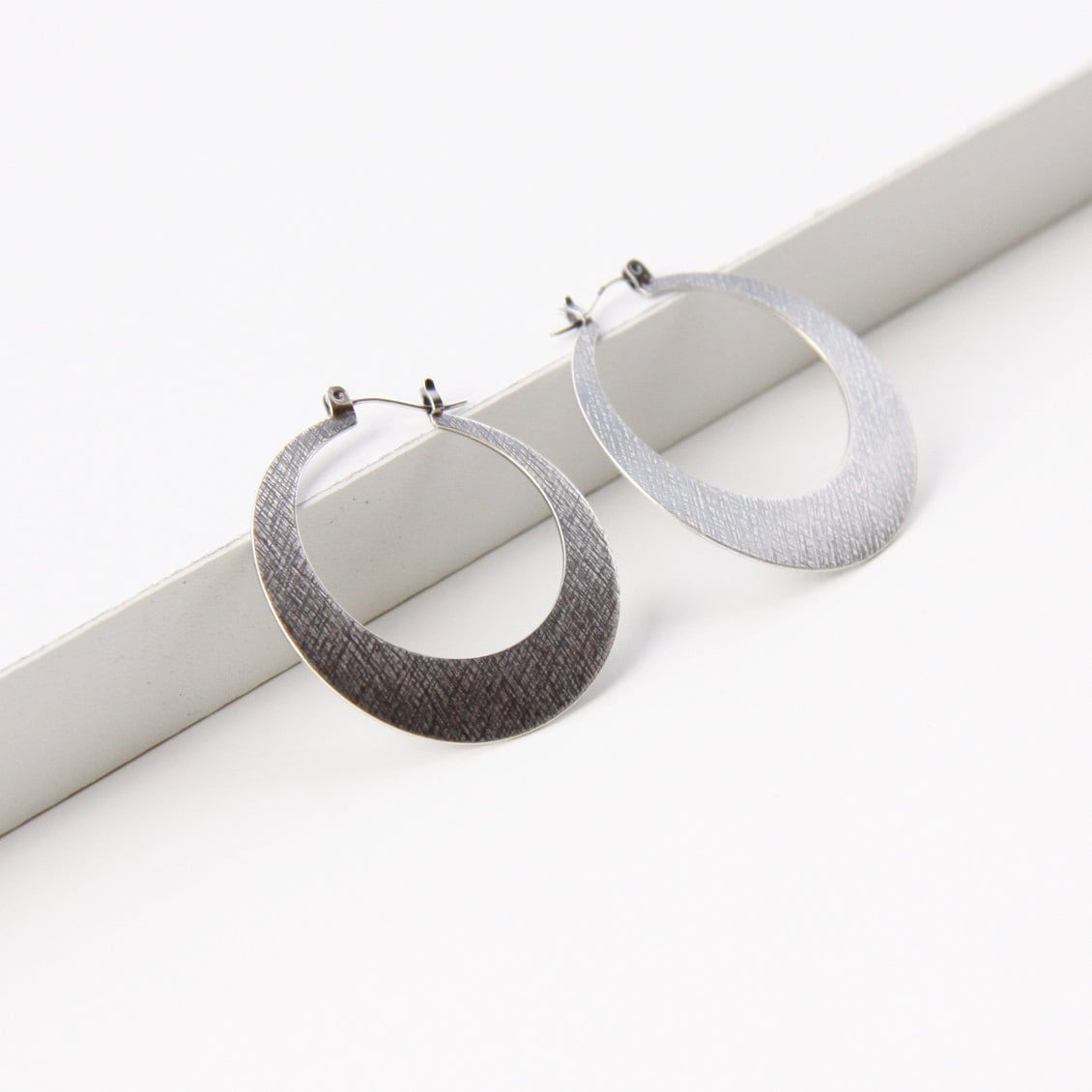 "Modern silver hoop earrings, sleek design in crescent moon shape sturdy and lightweight design for everyday wear - ""Silver Lunar Hoops"""