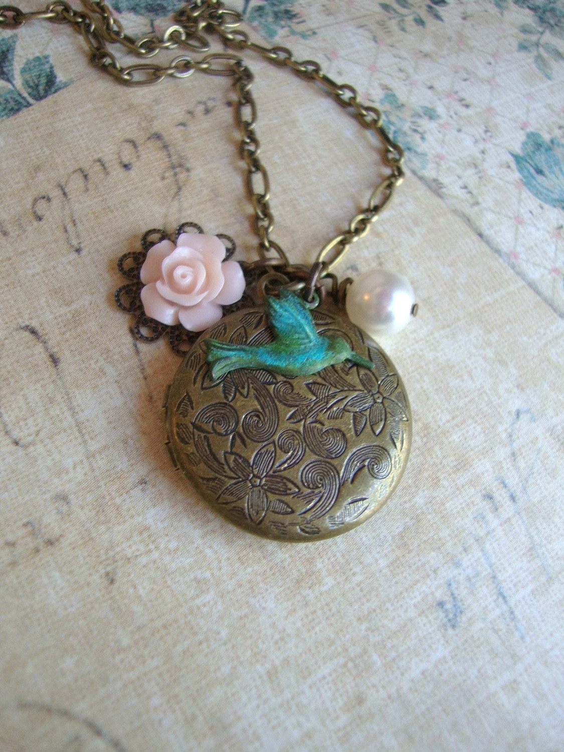Mouseover the photos Hummingbird Locket Necklace