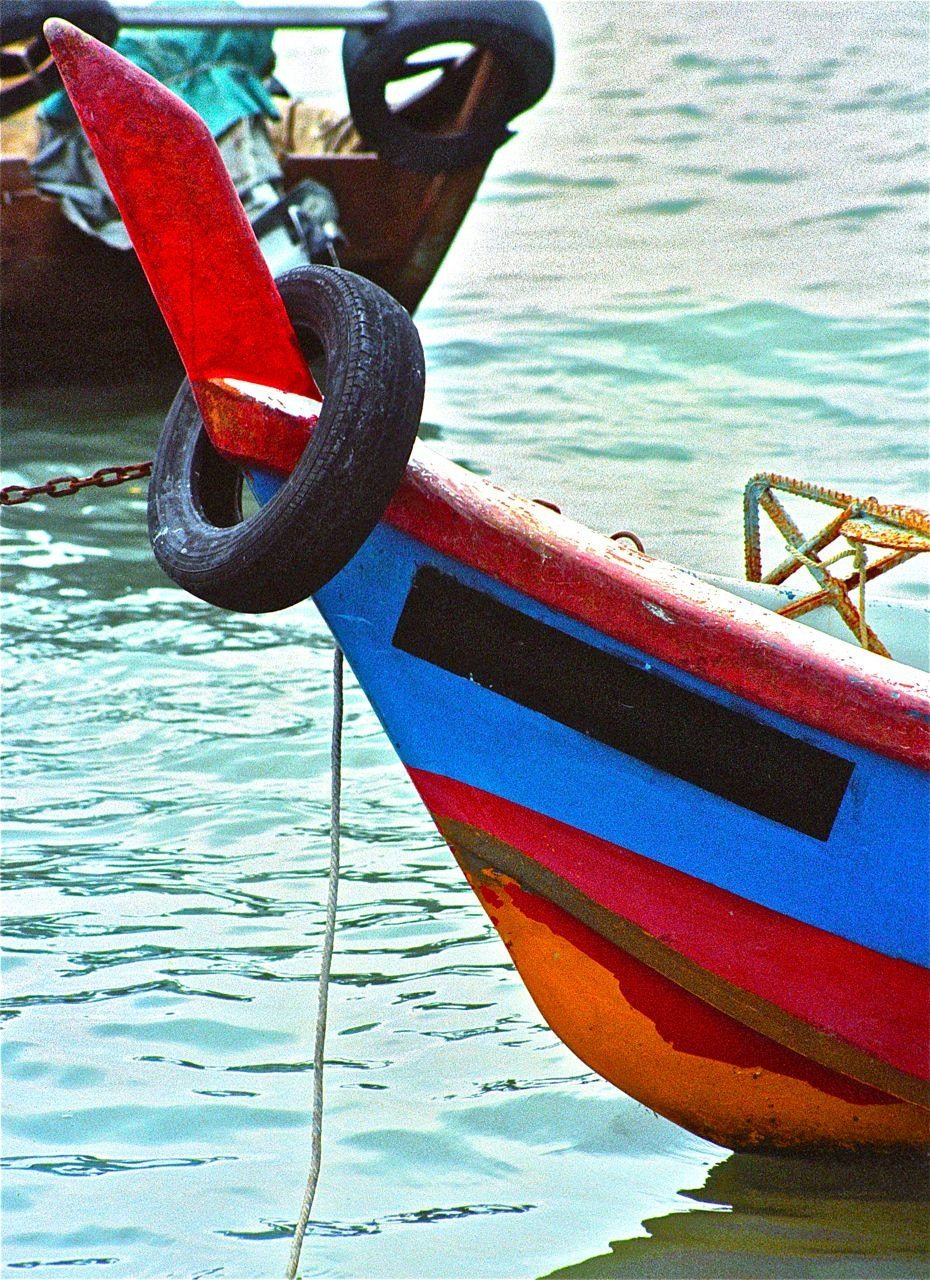 PHOTOGRAPH turquoise red cobalt blue red orange black boat Asia travel ocean water sea rubber tire  abstract - elephantdreams