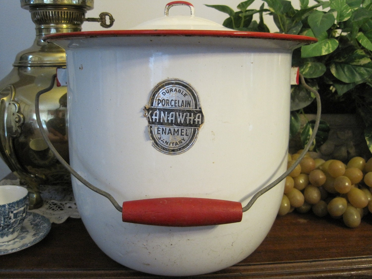 old white enamel pots with red trim