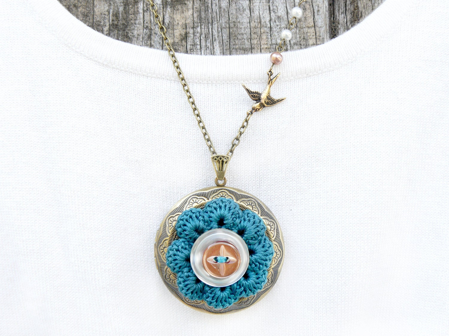 Crochet Flower Locket with Ocean Teal 100% Cotton Thread, Small Bird in Flight Charm and Glass Crystal Mini White and Beige Pearls - MakingsofShannaTice