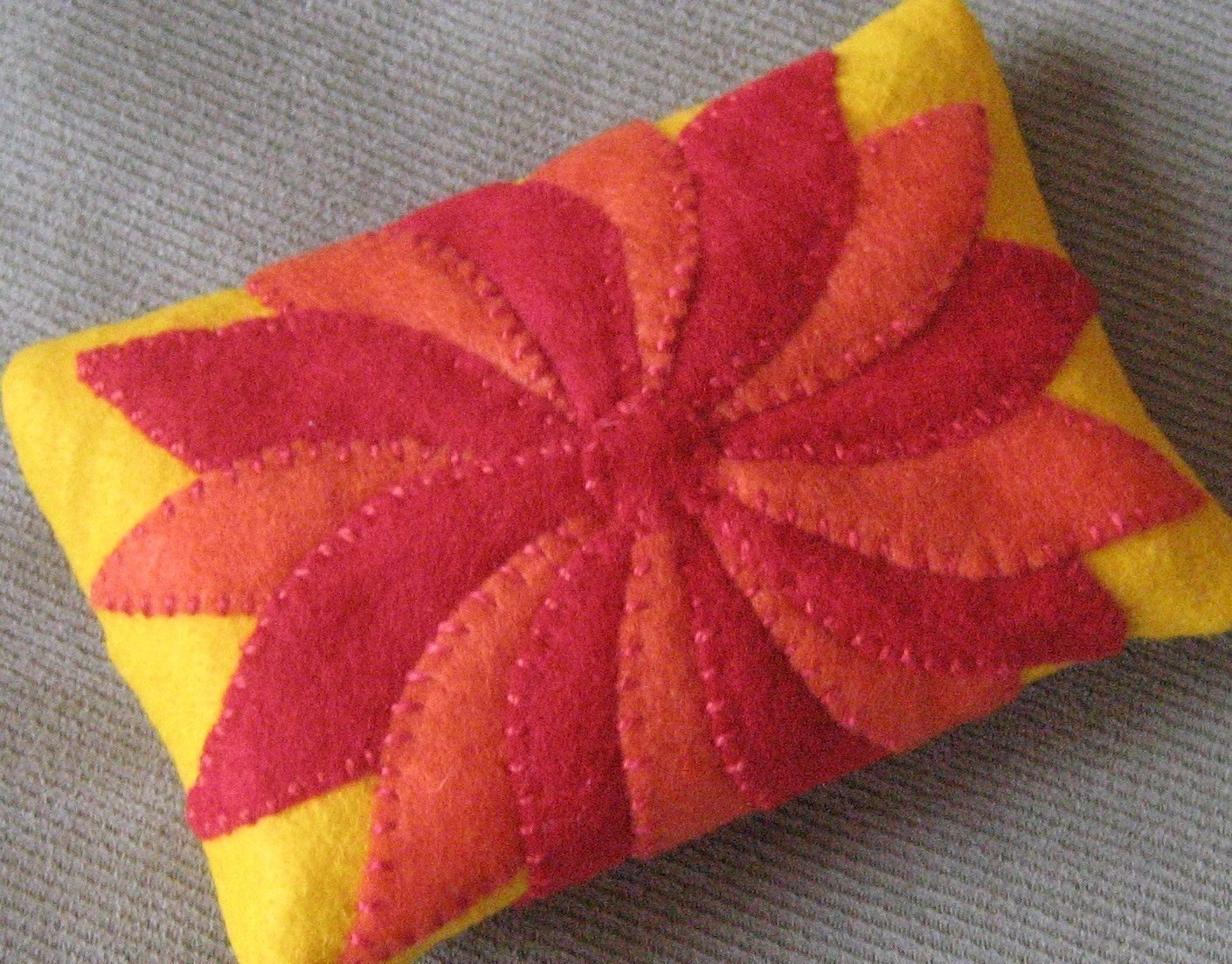 Red and Orange Pinwheel Flower on Yellow Tissue Cozy - FELTITNYC