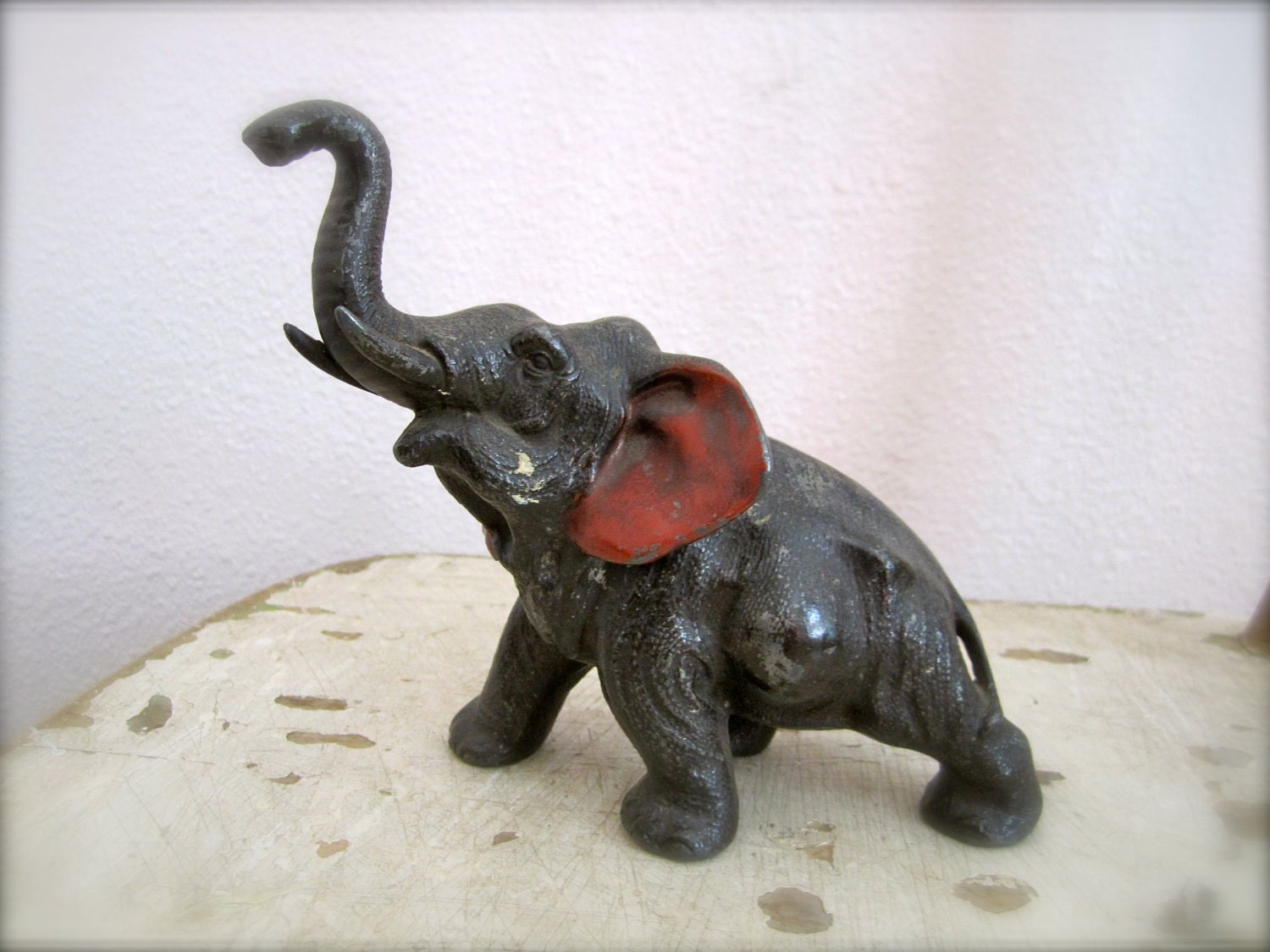 A large metal vintage elephant toy