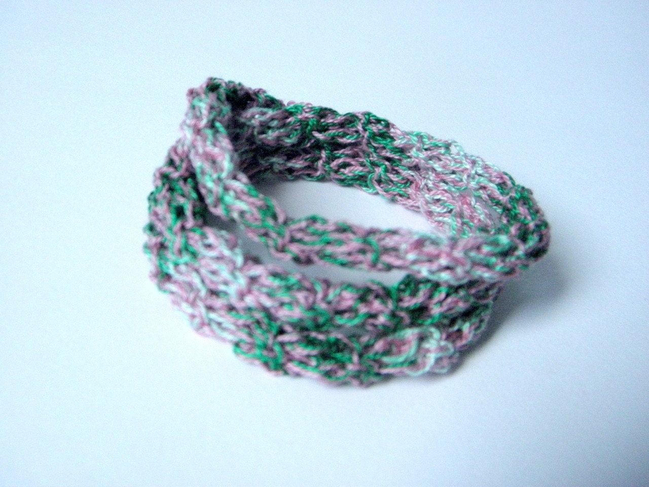 Crochet bracelet made of cotton pink and green gradient color