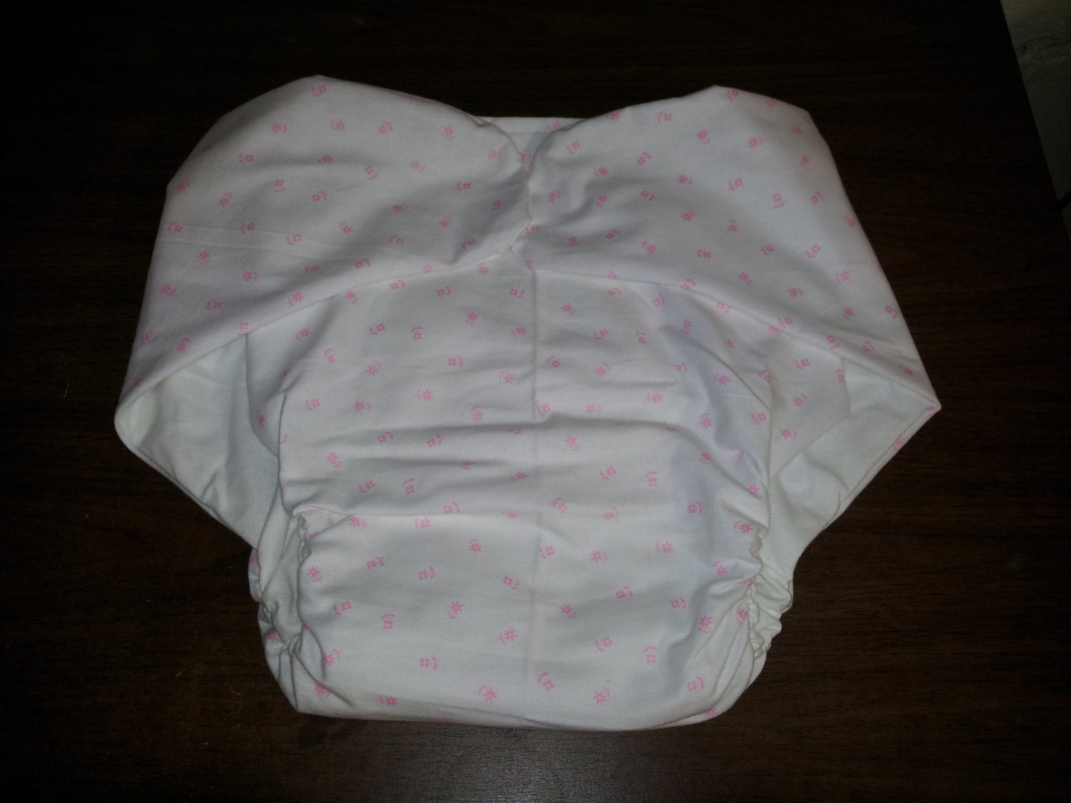 This is an adult sized cloth diaper. This diaper is 100% cotton flannel.
