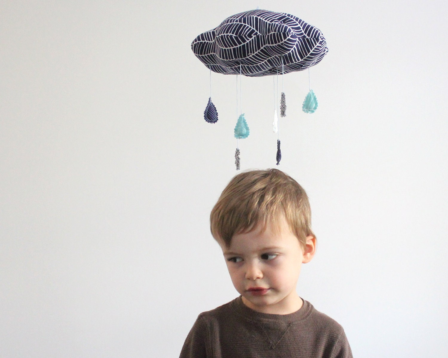 Little Storm Cloud Mobile - fabric sculpture for baby nursery decor in gray, navy, white, and dusk blue - BabyJivesCo