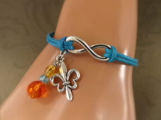 Fleur de Lis Infinity Charm Bracelet - Blue Infinity Fleur de Lis Bracelet - Sky Blue Antique Silver Infinity Karma Bracelet - $5.29 USD