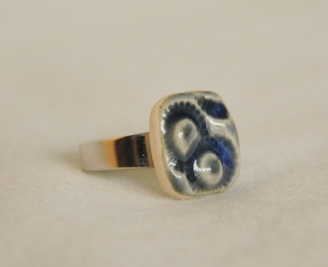 Stamped, ceramic, blue, adjustable ring.