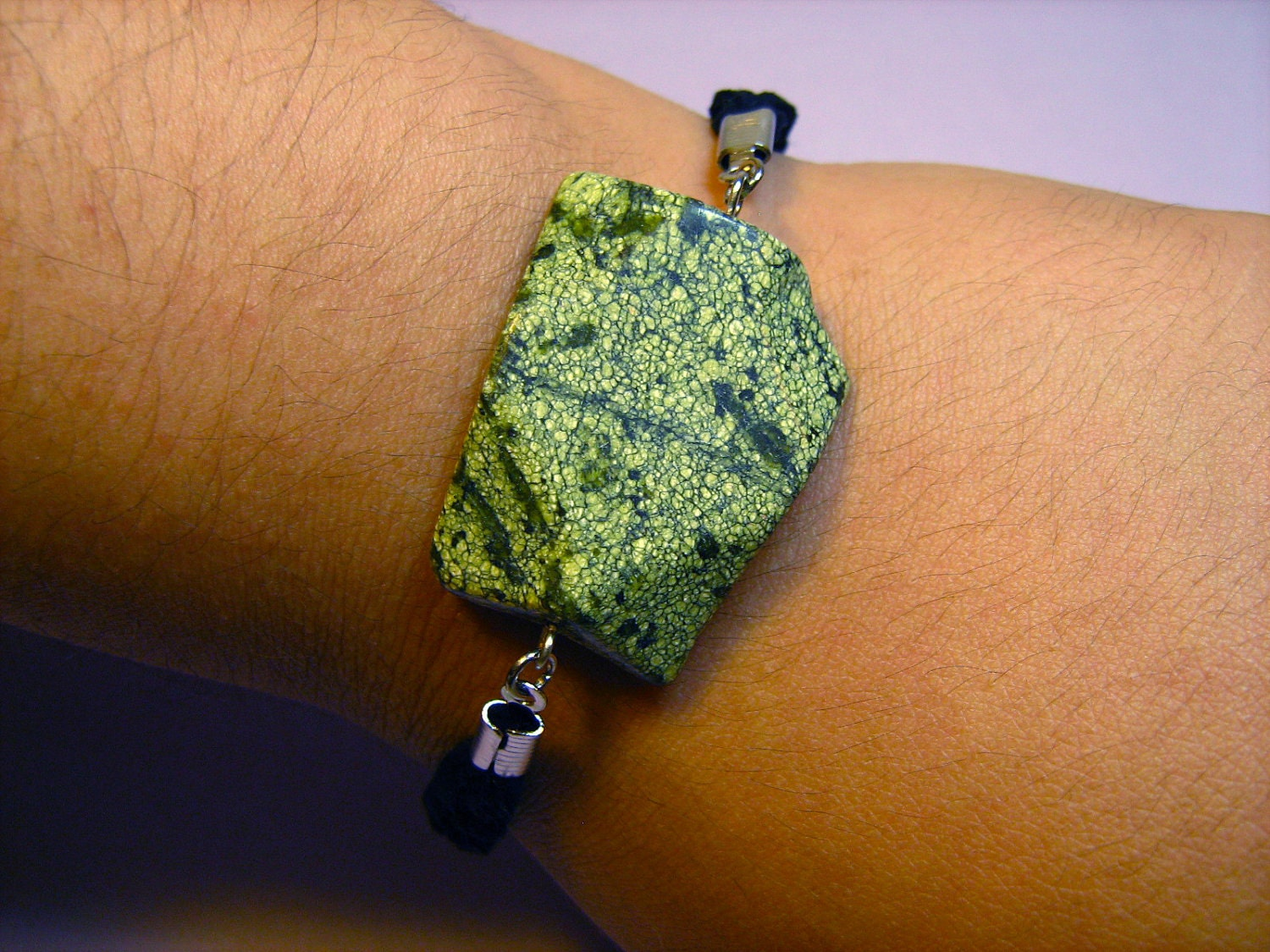Bracelet: Speckled Green Serpentine Stone with a Braided Black Suede Cord and Silvertone Findings, for Women
