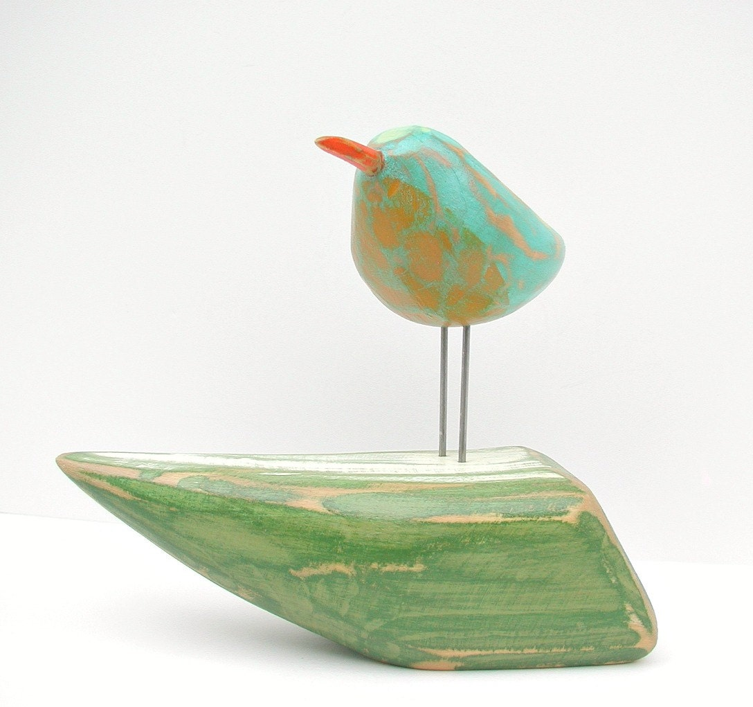 bird on boat woodcarving painted bird sculpture