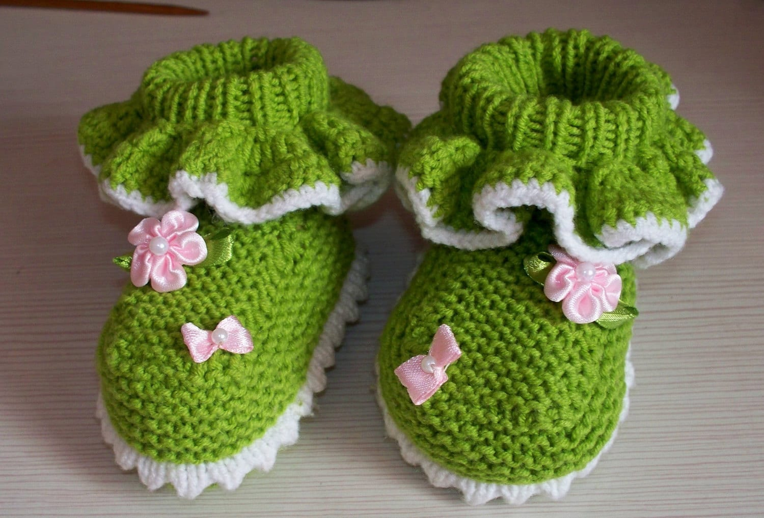 baby ankle booties with flounce and pink silk flowers