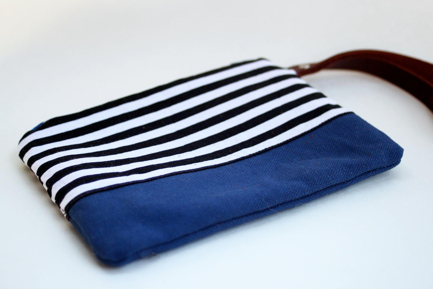 wristlet clutch in black and white stripe and blue