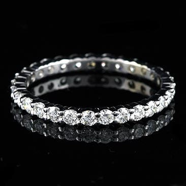 This eternity diamond band is made of 18k white gold and is 21 mm wide