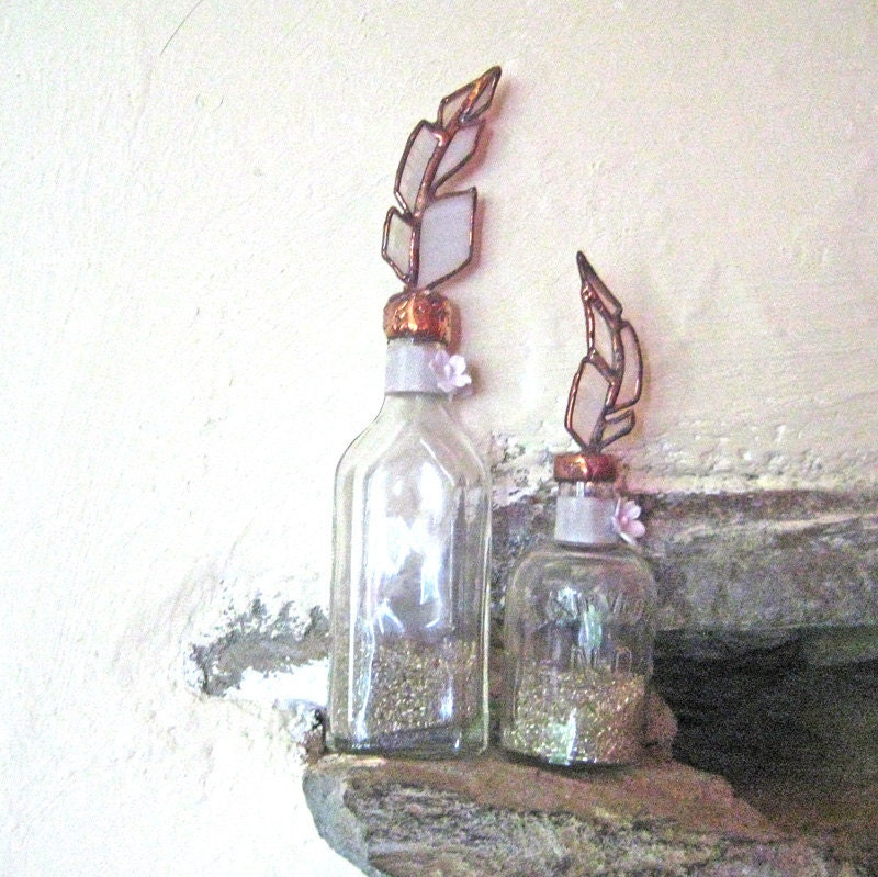From The Alchemists Shelf - 2 stained glass feather topped vintage bottles