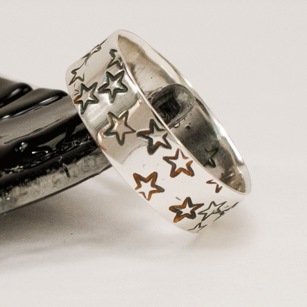 Stars Wide Ring Wedding Band by dashery on Etsy from etsy.com