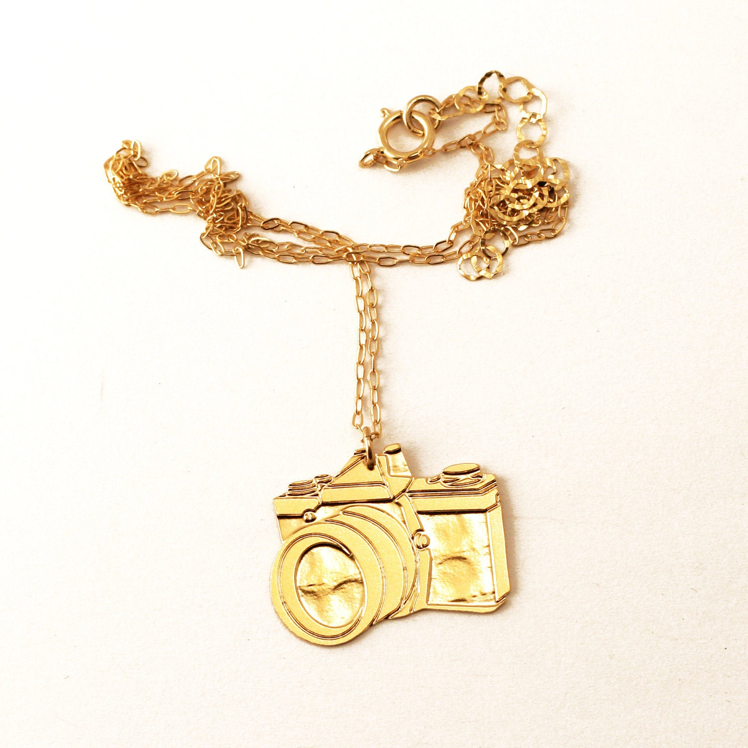 CAMERA- wild thing golden pendant