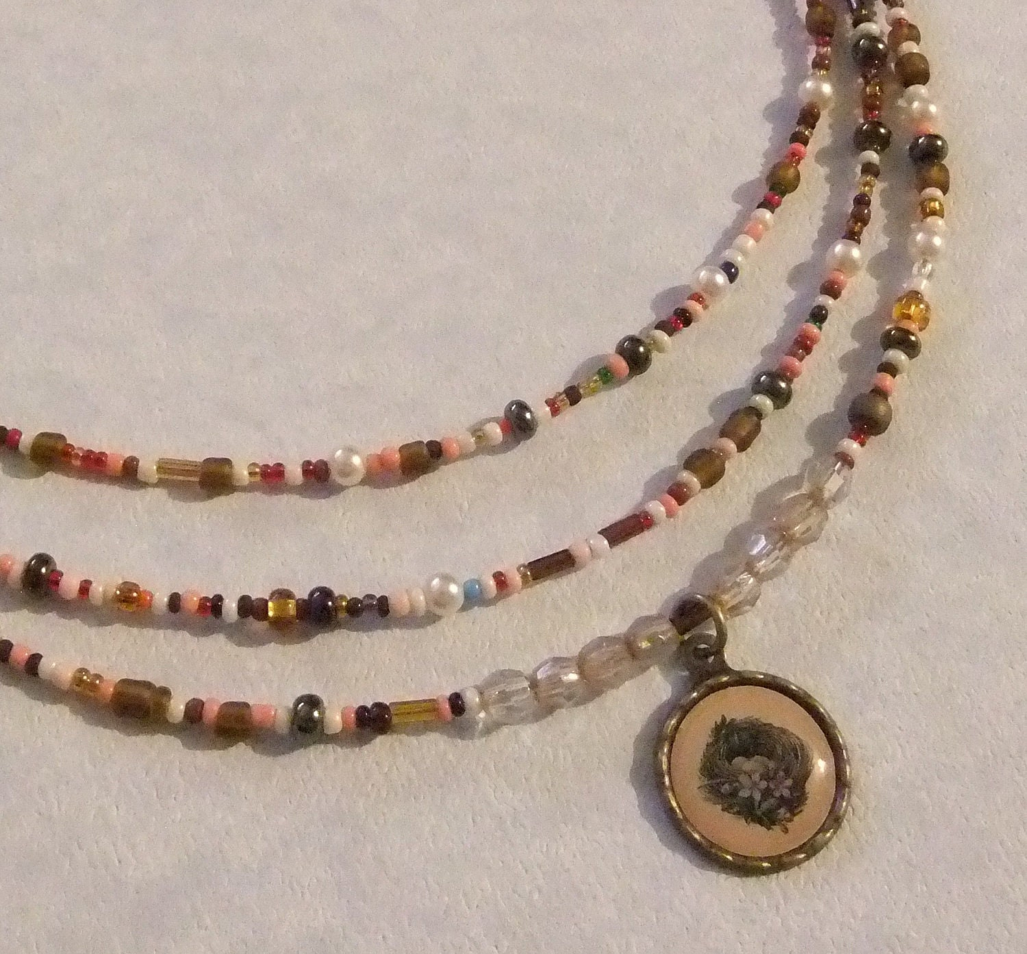 Seed Bead, Crystal, Pearl, Brass and Birdnest Charm Necklace - centerofbalance