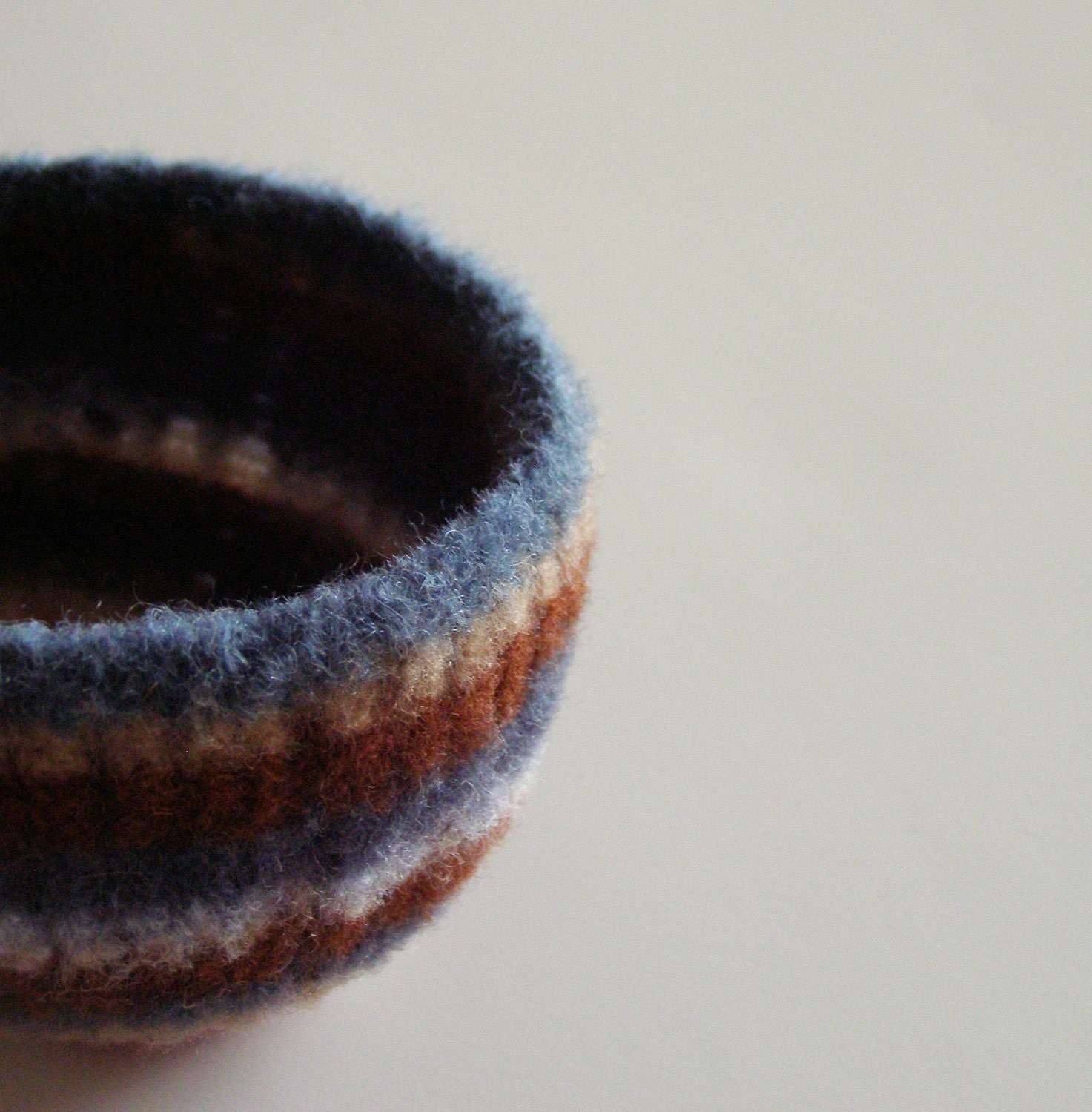felted wool striped bowl - earth tone stripes of blue, brown, tan, nougat, chestnut, dark red, and yellow - desk organizer - back to school - theFelterie