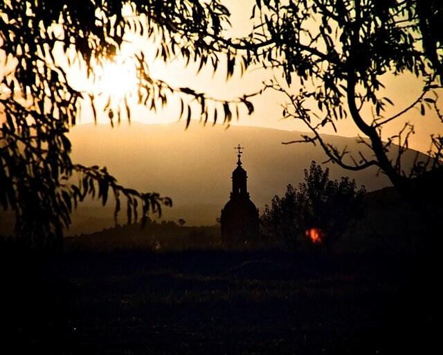 Sunset in Puente La Reina - 8x10 Fine Art Photograph.   Sunset. Silhouette of a church.  Gold and ochre tones.  Camino de Santiago.  Home decor. - trekkerjen