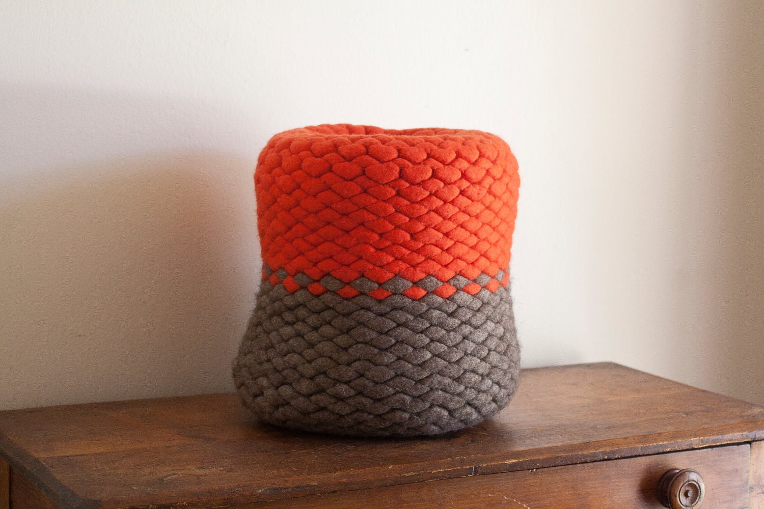 Wool felt knit pod vessel in bright orange and natural gray brown
