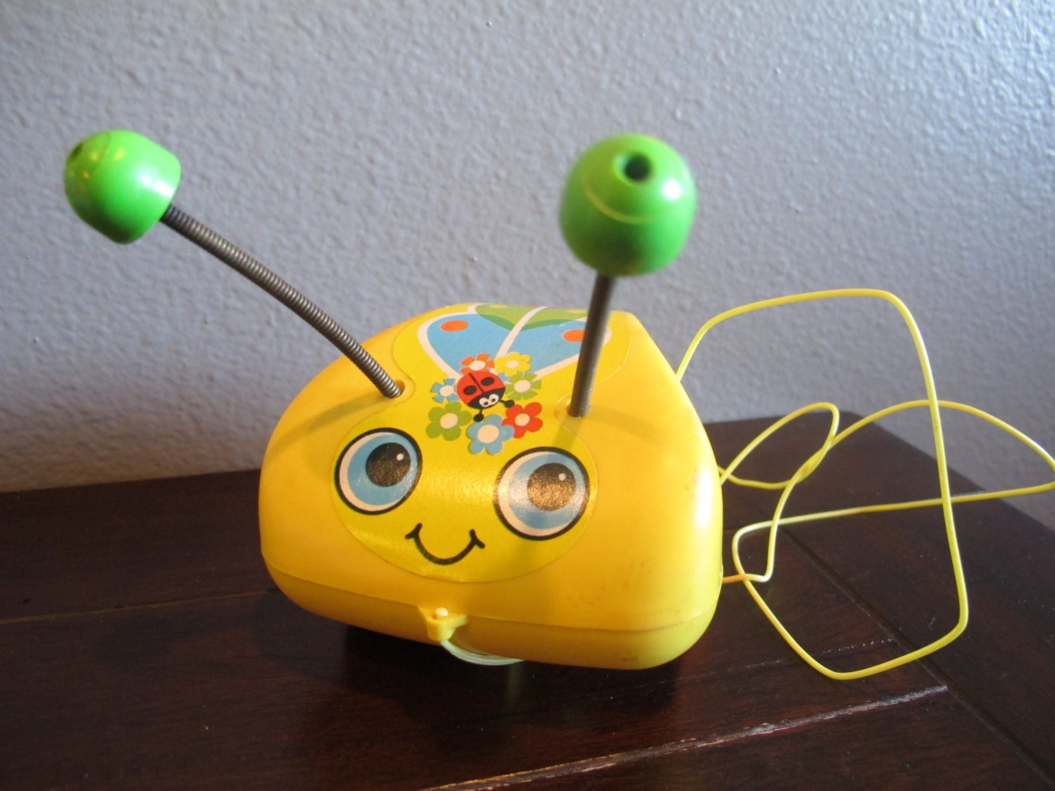 Vintage Tug a Bug butterfly Fisher Price pull toy - DroolINC