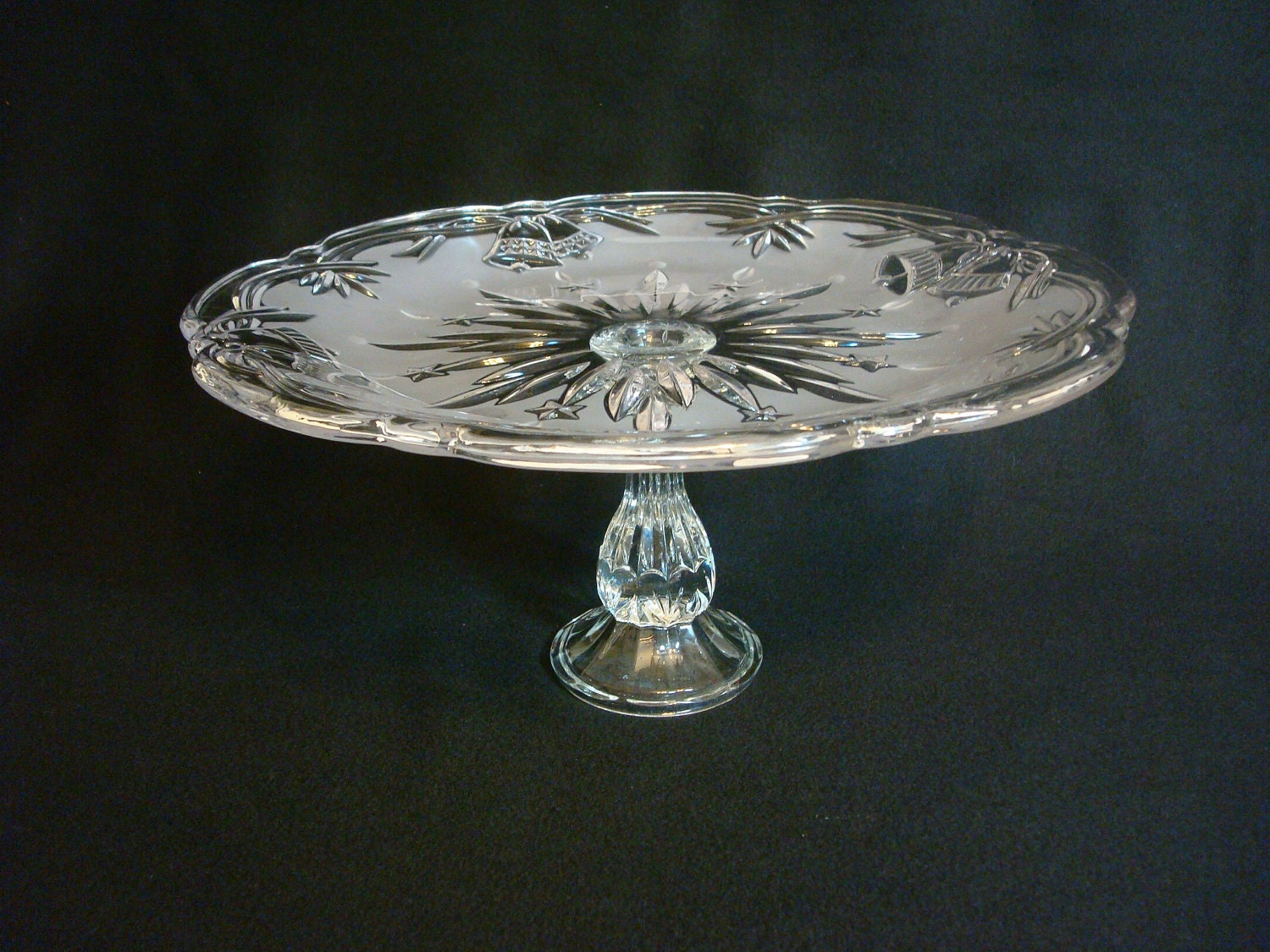 Short pedestal wedding cake stand made with re-purposed glass.  Frosted glass with wedding bells.