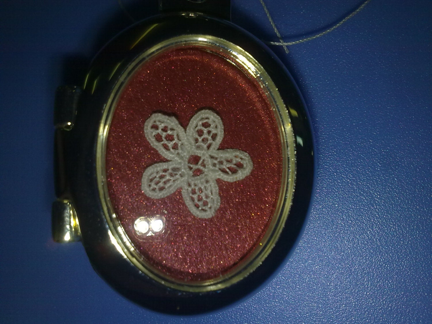 Handmade Kenmare Lace inset in a silver Keyring