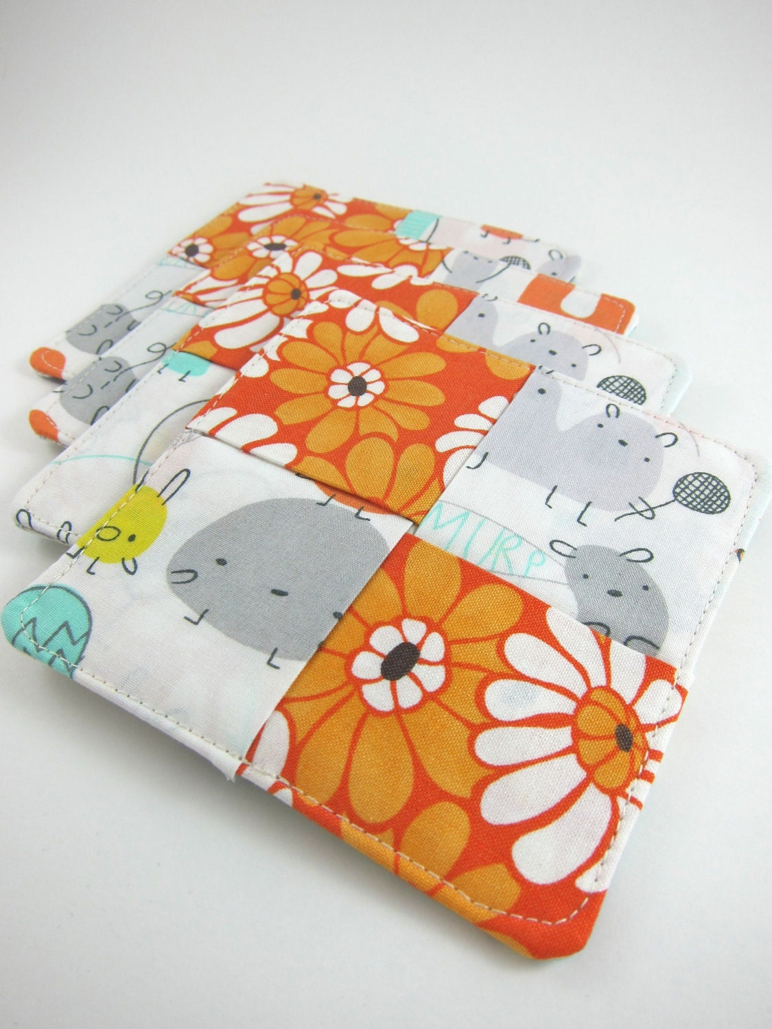 Housewarming GIft Fabric Coasters Set of 4 - Reversible with Storage Bag - Cute Monsters and Orange Flowers