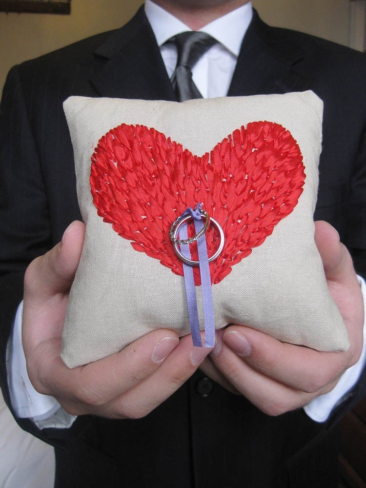 Linen ring pillow embroidered with big, red heart